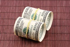 Rolls of Money. US paper currency bills rolled up and tied with a yellow rubber band. Empty inside Royalty Free Stock Photos