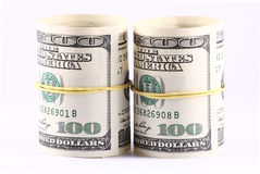 Rolls of Money. US paper currency bills rolled up and tied with a yellow rubber band. Empty inside Stock Photos