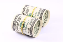 Rolls of Money. US paper currency bills rolled up and tied with a yellow rubber band. Empty inside Stock Images