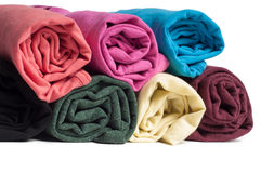 Rolls of multicolored clothes Stock Photos