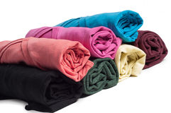 Rolls of multicolored clothes Royalty Free Stock Photos