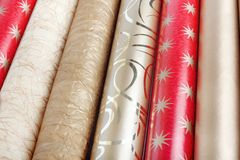 Rolls of multicolored wrapping paper Stock Photos