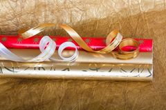 Rolls of multicolored wrapping paper with streamer for gifts Royalty Free Stock Photo