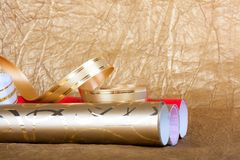Rolls of multicolored wrapping paper with streamer for gifts Royalty Free Stock Images