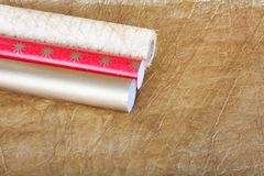 Rolls of multicolored wrapping paper with streamer for gifts on Royalty Free Stock Images