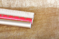 Rolls of multicolored wrapping paper with streamer for gifts on Stock Photo
