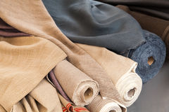 Rolls of natural linen cloth. Lie on the market counter Stock Photo