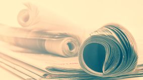 Roll of newspapers. Rolls of newspapers in vintage tone stock photos