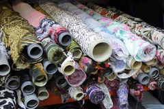 Rolls Of Colored Fabrics In The Fabric Store, With Ornaments Stock Images
