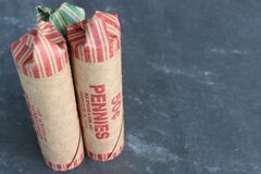 Free Rolls Of Dimes And Pennies Against Dark Background. Royalty Free Stock Photos - 196214718