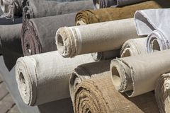 Free Rolls Of Linen Canvas Textile On Market Stall Royalty Free Stock Photography - 104255577