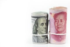 Roll of one hundred US dollar bills and chinese yuan banknotes w royalty free stock photo