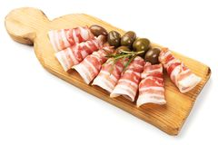 Rolls of pancetta bacon isolated on white stock photo