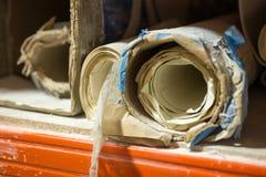 Rolls of Paper on Dusty, Splattered Shelf Stock Photography