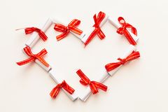 Rolls of paper tied with red ribbon Stock Image