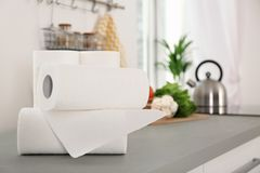 Rolls of paper towels on table stock photos