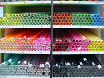 Rolls of papers. Rolls of colourful papers on the shelves Royalty Free Stock Photos