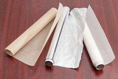 Rolls of parchment paper and aluminum foil for household use Stock Photos