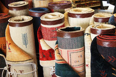 Rolls or Persian carpets. Rolls of Persian carpets for sale in market Stock Image