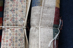 Rolls or Persian carpets. Rolls of Persian carpets ready for delivery Royalty Free Stock Photos
