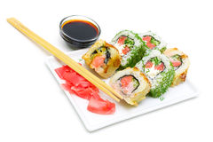 Rolls, pickled ginger on a plate and soy sauce on a white backgr Stock Image
