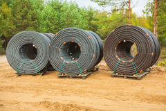 Rolls of pipes in forest Royalty Free Stock Image