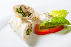 Rolls from pita bread stuffed with meat salad and cheese Stock Images