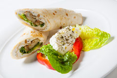 Rolls from pita bread stuffed with meat salad and cheese Royalty Free Stock Photo