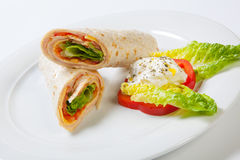 Rolls from pita bread stuffed with salad cheese ham and vegetables Stock Image