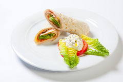 Rolls from pita bread stuffed with salad cheese ham and vegetables Royalty Free Stock Photography