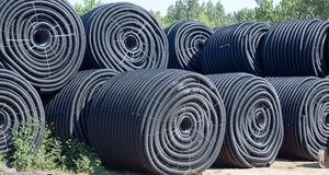 Rolls of Plastic Drainage Pipe Stock Photos