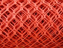Rolls of plastic fence mesh. / safety warning net stock images
