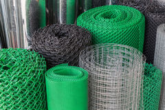 Rolls of plastice and steel wire mesh Stock Images