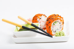 Rolls on the plate with chopsticks Stock Photography