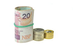 Rolls of polish banknotes and coins isolated on white Stock Photo