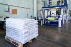 Rolls of polyethylene or polypropylene film in a warehouse stock photos