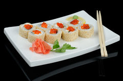 Rolls with red caviar and sesame Stock Photography