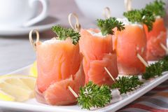 Rolls of red fish with cream cheese close-up horizontal Royalty Free Stock Images