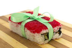 Rolls with a ribbon on a cutting board horizontal Stock Image