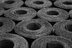 Rolls of roofing felt. Closeup of Rolls of new black roofing felt or bitumen royalty free stock photography
