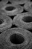 Rolls of roofing felt. Closeup of Rolls of new black roofing felt or bitumen Royalty Free Stock Images