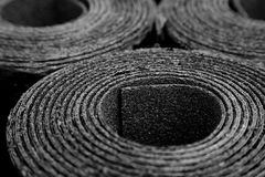 Rolls of roofing felt. Closeup of Rolls of new black roofing felt or bitumen Royalty Free Stock Photos