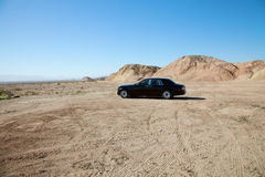 Rolls Royce car parked on unpaved road with tire tracks Royalty Free Stock Photo