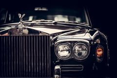 Rolls-Royce - classic British car on black background, close-up. Royalty Free Stock Image