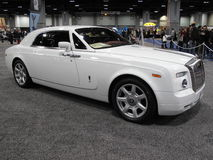 Rolls Royce Dream Car. Photo of rolls royce luxury car at the washington dc auto show on 1/29/10.  This expensive car is roped off yet visible for those who Royalty Free Stock Photography