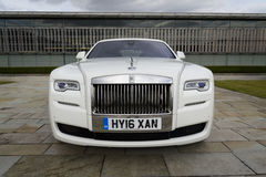 Rolls-Royce Ghost in front of the Goodwood plant on August 11, 2016 in Westhampnett, United Kingdom. Royalty Free Stock Images
