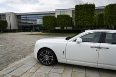 Rolls-Royce Ghost in front of the Goodwood plant on August 11, 2016 in Westhampnett, United Kingdom. Stock Photos