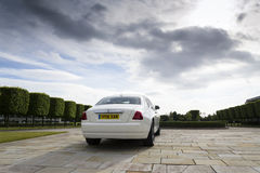 Rolls-Royce Ghost in front of the Goodwood plant on August 11, 2016 in Westhampnett, United Kingdom. Royalty Free Stock Photography