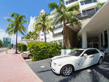 Rolls Royce luxury car next to a famous hotel at Miami Beach Stock Images