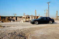 Rolls Royce parked in front of abandoned houses Royalty Free Stock Images